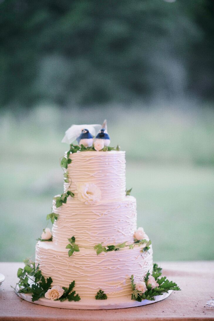 After dinner, Michele and David treated their guests to a decadent slice of wedding cake. The three-tier confection crafted by Lulu's Bakery featured combed buttercream, cascades of ivy and ivory lisianthus to achieve an elegant-meets-rustic feel.
