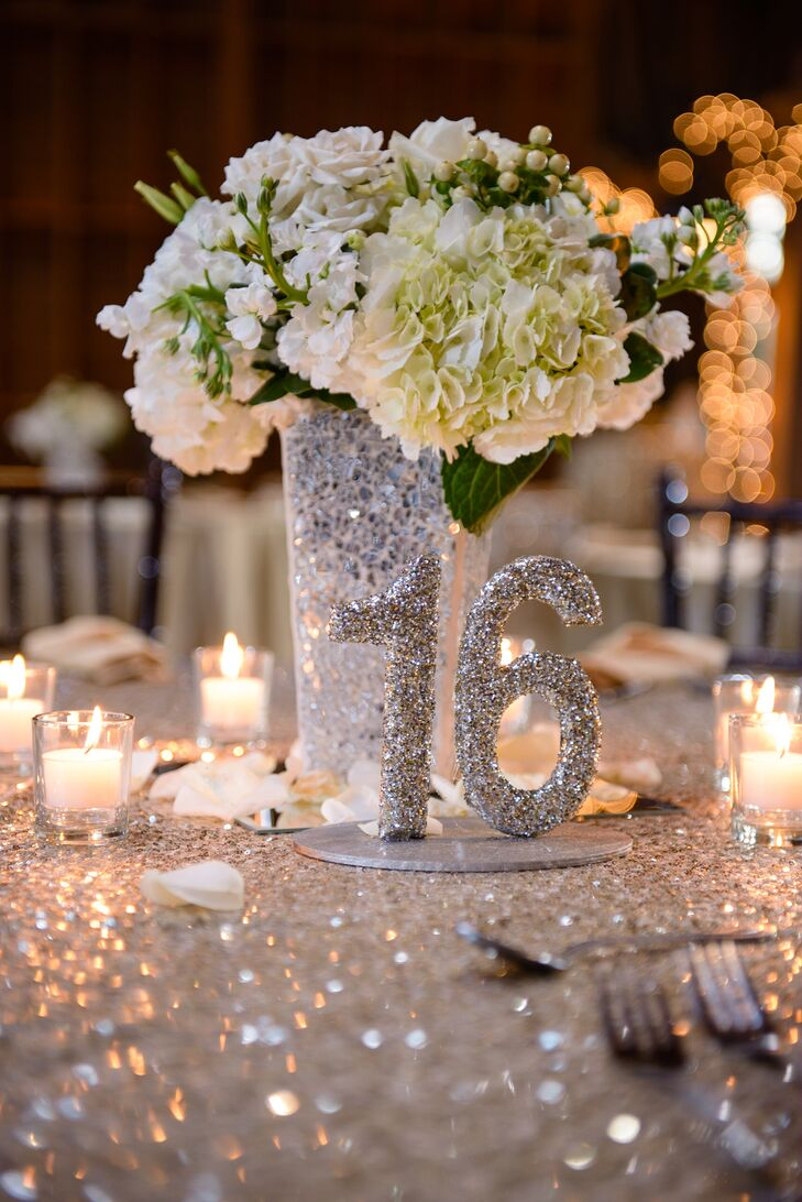 The couple decided on champagne tablecloths with gold sequin overlays and white hydrangea and rose arrangements similar to the bride's bouquet.