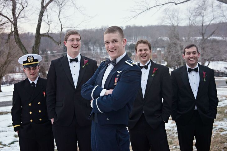 The groomsmen who weren't in the Air Force wore classic black tuxedos with red calla lily boutonnieres while the groom and his Air Force friends wore their uniforms.