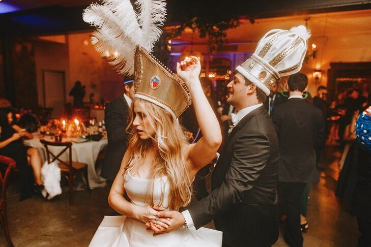 Bride and Groom Wearing Foam Crowns for Traditional La Hora Loca