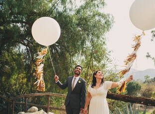 Although the grounds at Angelus Mountain Center overlook the bustling downtown Los Angeles area, anyone who attended this rustic wedding decked out in