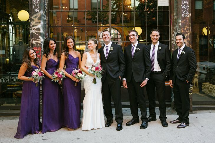 Purple was the color of choice for the wedding party--the bridesmaids' floor-length purple gowns complemented the groomsmen's purple striped ties.