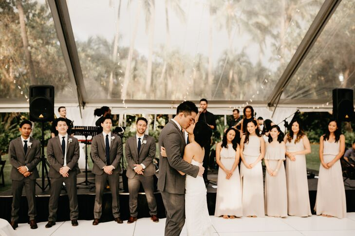 Chanel and Brett share their first dance, performed by the Island Kings Band, as their bridal party looks on.