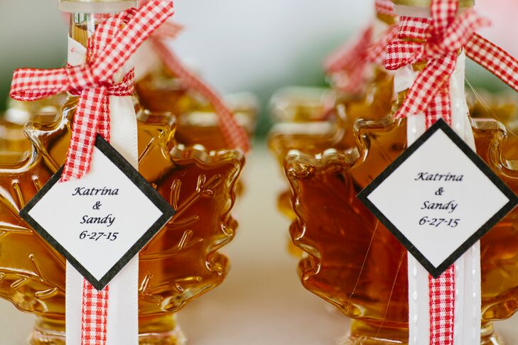 Guests took home mini bottles of Vermont maple syrup and  mason jar shot glasses as favors.