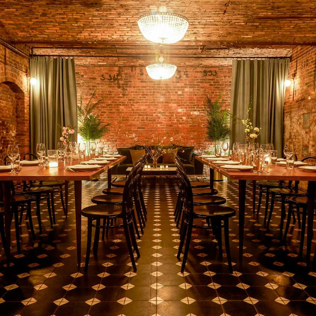 Situated on the Williamsburg waterfront in Brooklyn, NY, the Wythe Hotel offers its Cooper Room event space. This venue boasts a 120-year-old history and was once a functioning factory. The building was carefully restored in 2014 and still retains many of its original features.  The Space The Cooper Room is located in the cellar of this venue and provides a stunning space for an array of intimate events. Both the walls and ceiling of this space display exposed red brick. Antique crystal...