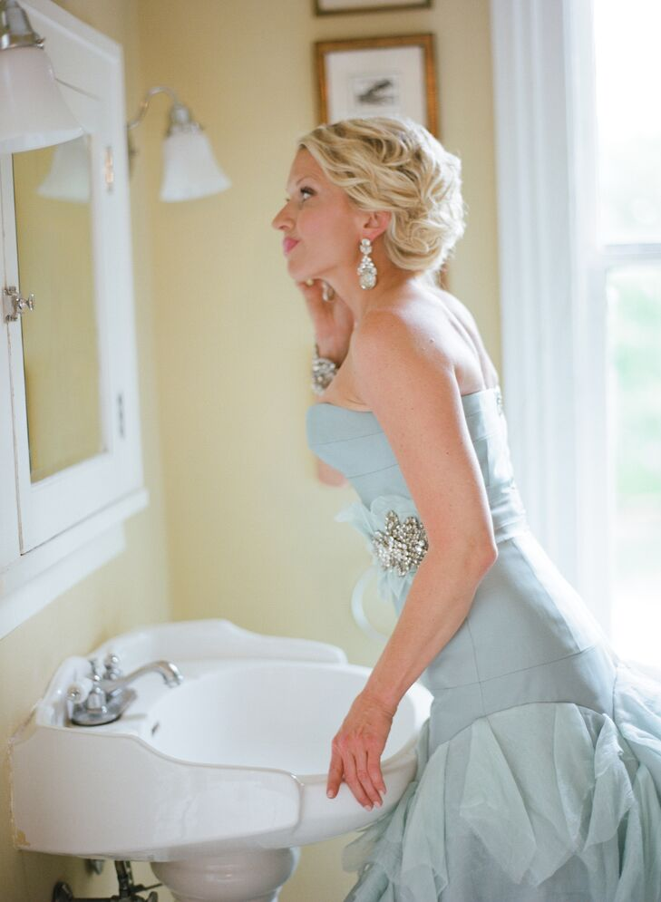Jennifer, in a unique blue wedding gown, added the final touches before meeting Piran before the ceremony.