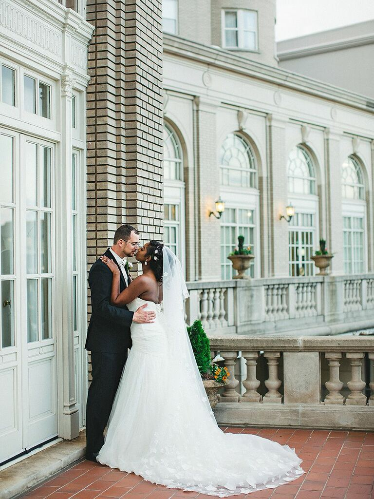 bride and groom kissing in Atlanta, GA