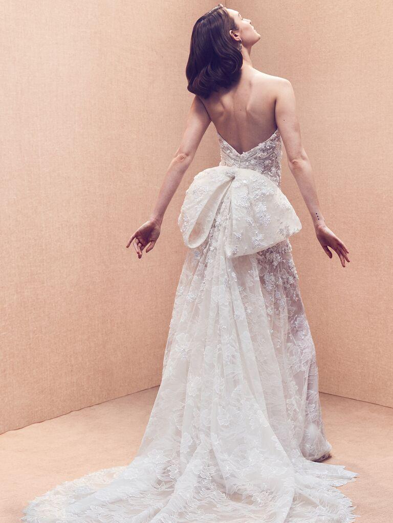 Oscar de la Renta Spring 2020 Bridal Collection floral-embellished wedding dress with oversize back bow detail