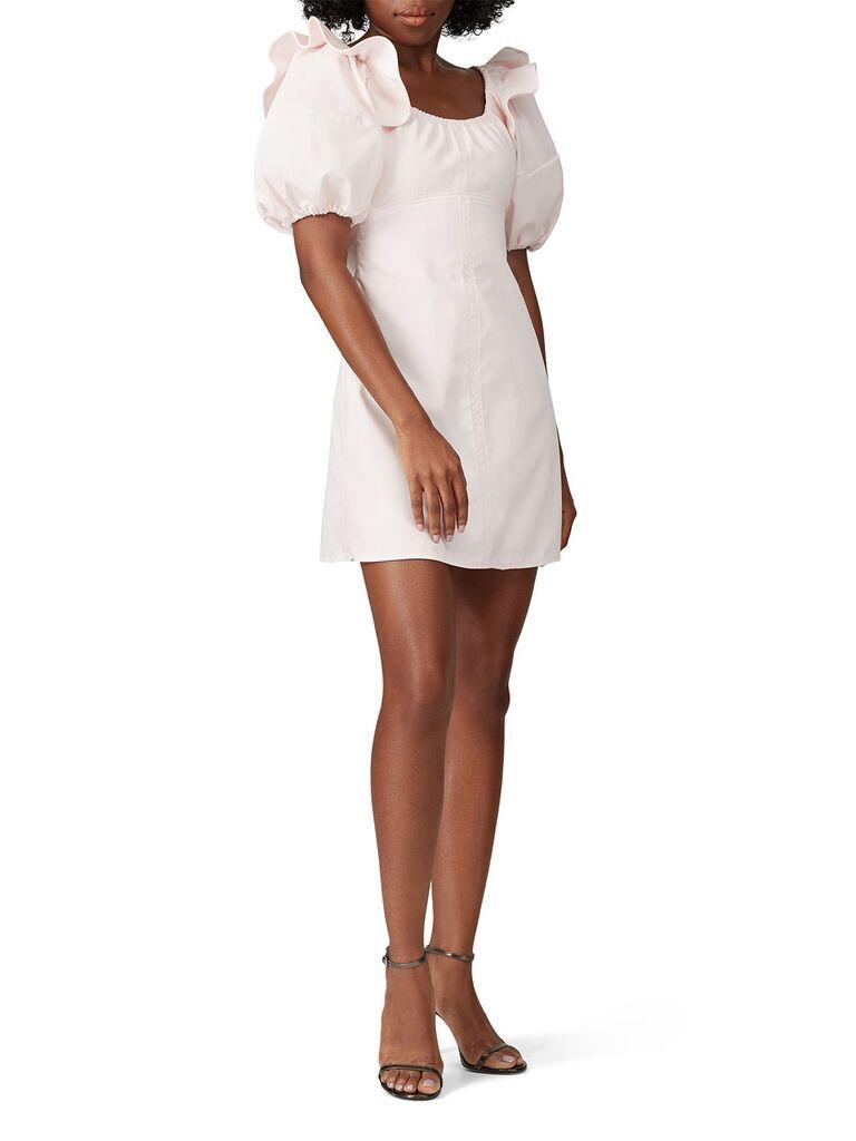 Blush mini dress with statement puff sleeves
