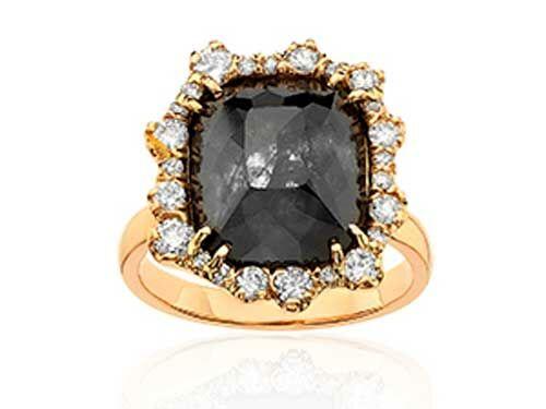 Black diamond engagement ring with sunburst diamond halo