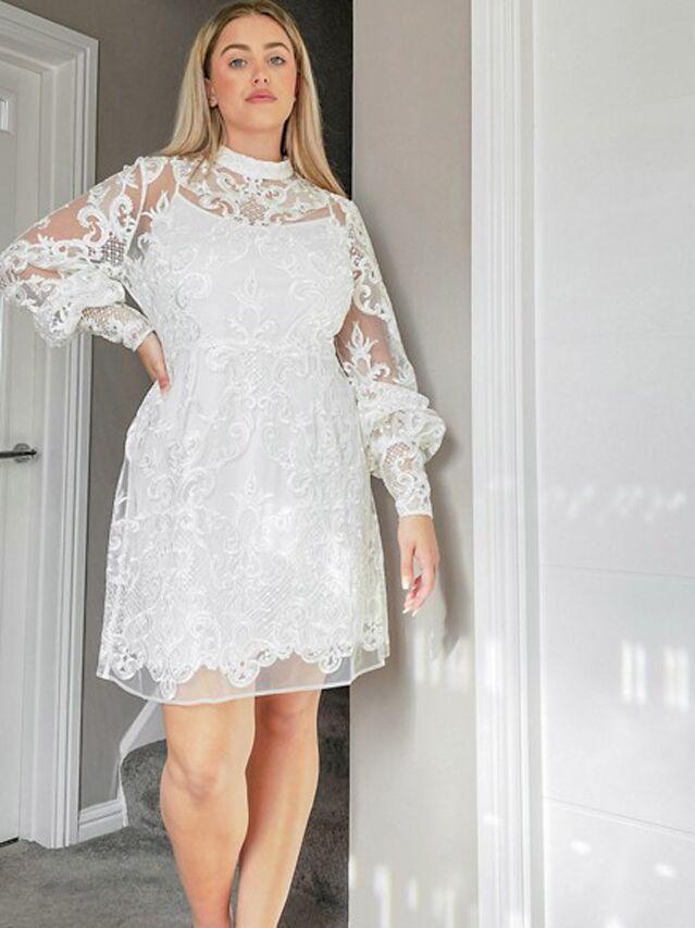 Long sleeve plus size white mini dress with embellished sheer sleeves