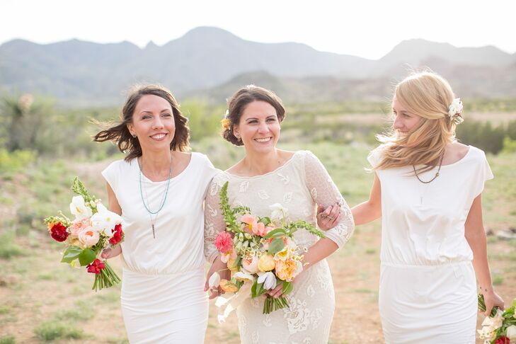 Valerie's bridesmaids (her two sisters) wore bright white midi dresses with low cutout backs paired with rustic brown leather bootees. Complete with Margot Wolf Jewelry-layered necklaces, their look was trendy and modern.