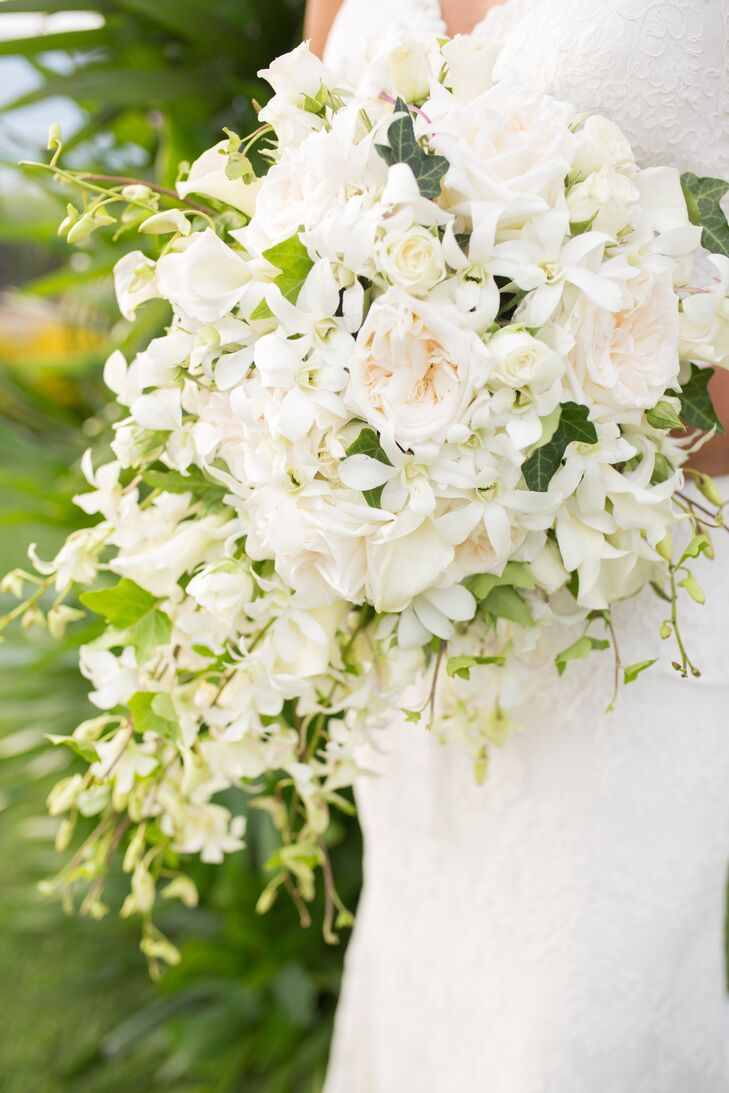 Bethany's bouquet was a cascading collection of white and ivory roses, dendrobium orchids and calla lilies.
