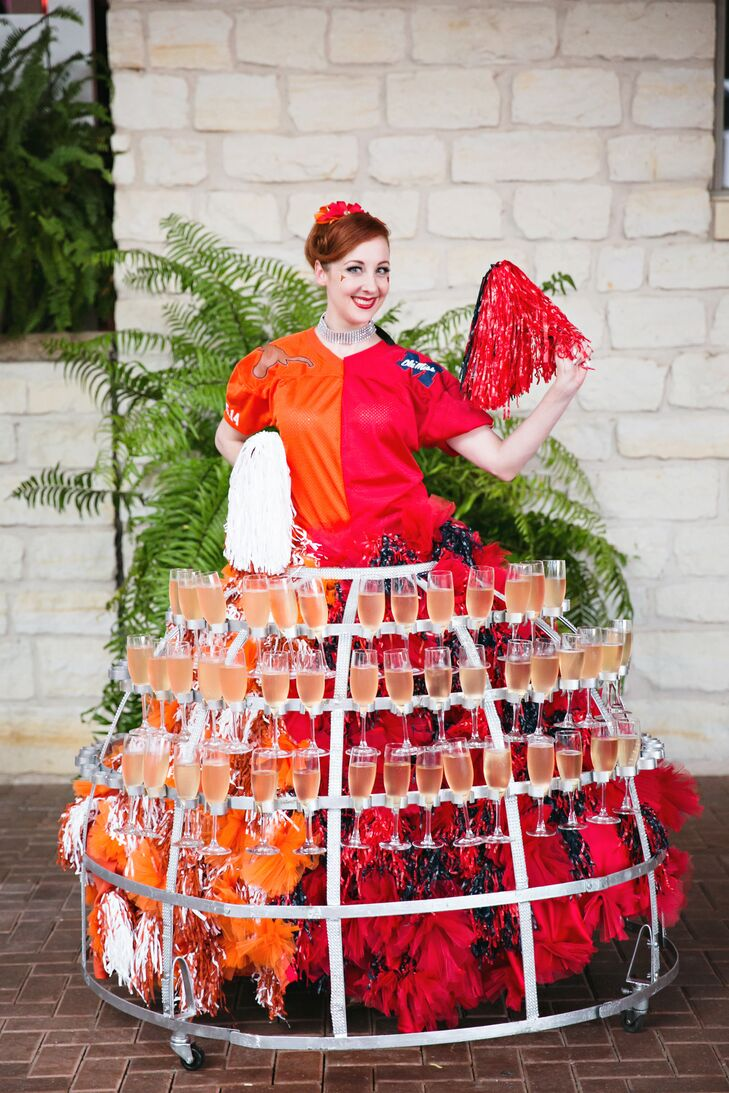 This champagne diva, wearing an Ole Miss/University of Texas-inspired dress, greeted guests as they entered Austin Country Club in Austin, Texas. Her metal skirt was filled with Kelly and Walt's signature cocktails.