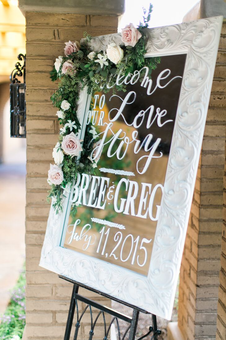 """We wanted lots of mirrors with calligraphy to decorate the ceremony, as well as the reception,"" says Bree. Several elegantly framed mirrors were decorated with blush roses and greenery."