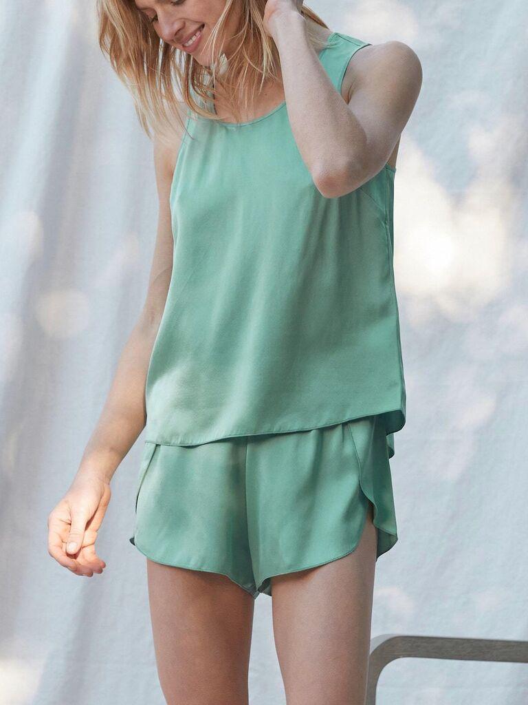 Woman wearing jade green silk pajama set