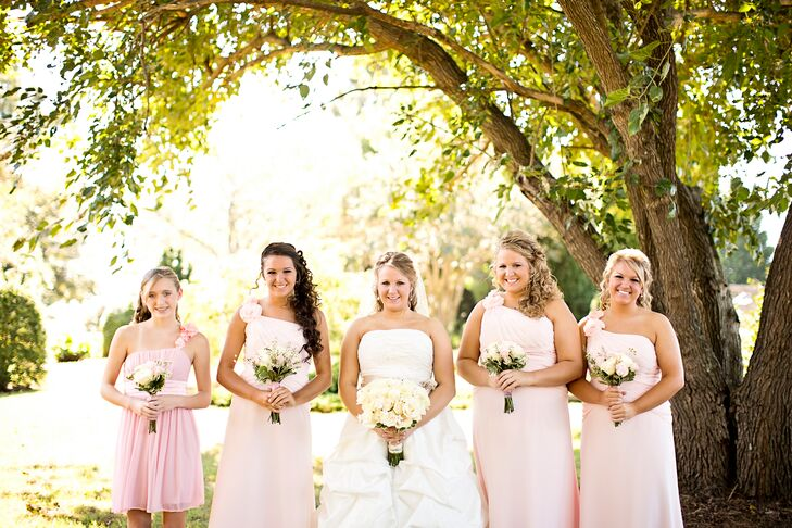 The blush bridesmaid dresses complemented Alexandria's off-white wedding gown.