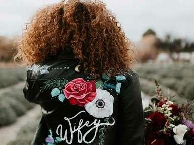 Bride wearing leather wedding jacket