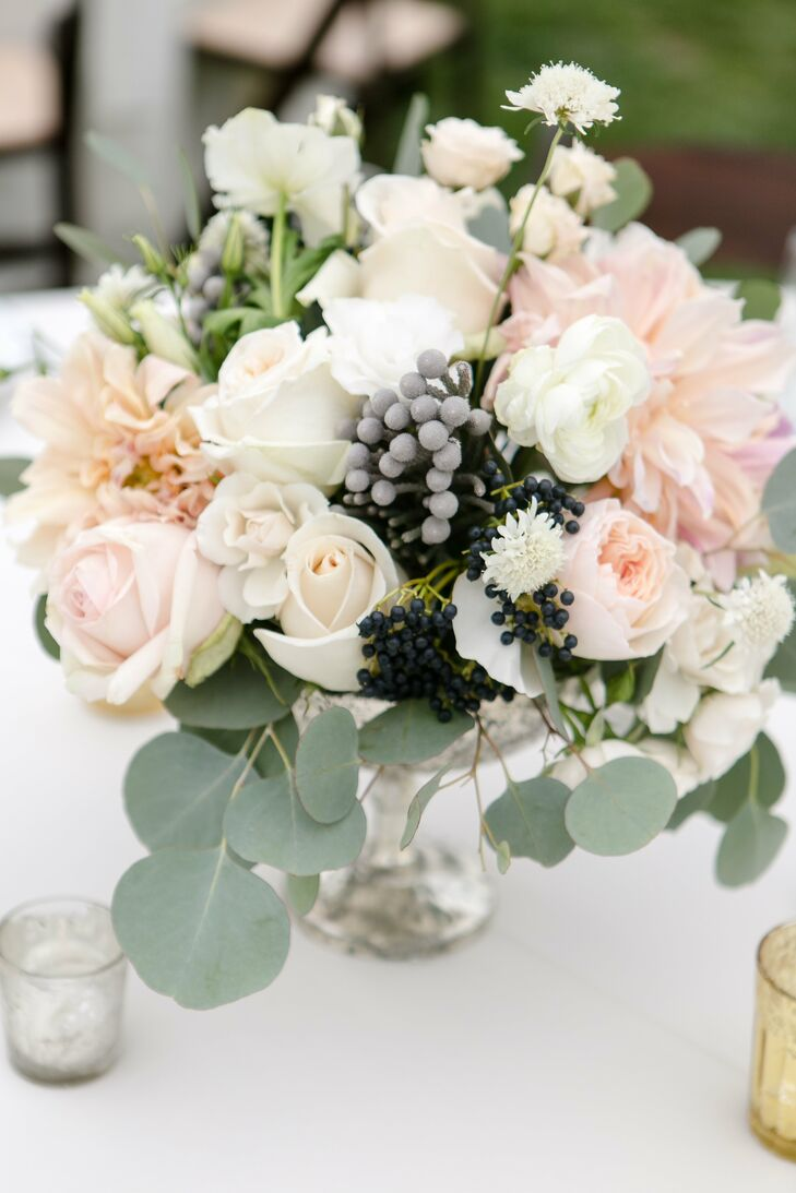 Allie's bridesmaid bouquets doubled as the centerpieces at the reception at Gerry Ranch in Camarillo, California. Repurposed in clear vases, the blooms added a romantic, soft and loose vibe to the ivory-draped tables.