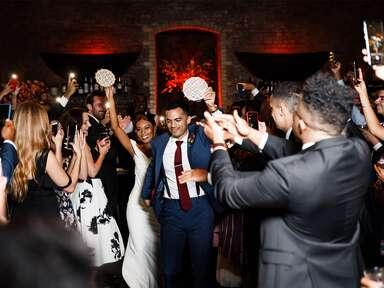 wedding couple dancing with tambourines