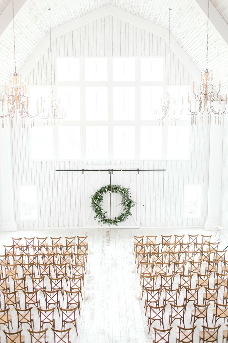Whitewashed Barn Ceremony with Cross-Back Chairs and Oversize Wreath Backdrop