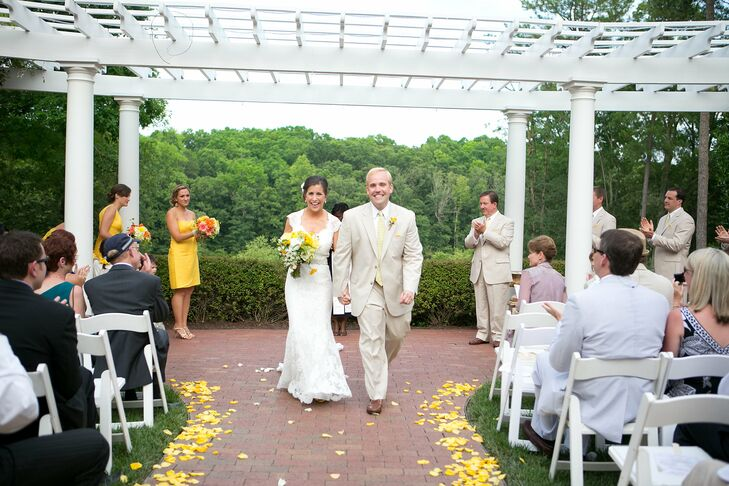 The evening nuptials took place beneath a pergola and overlooked a lake.