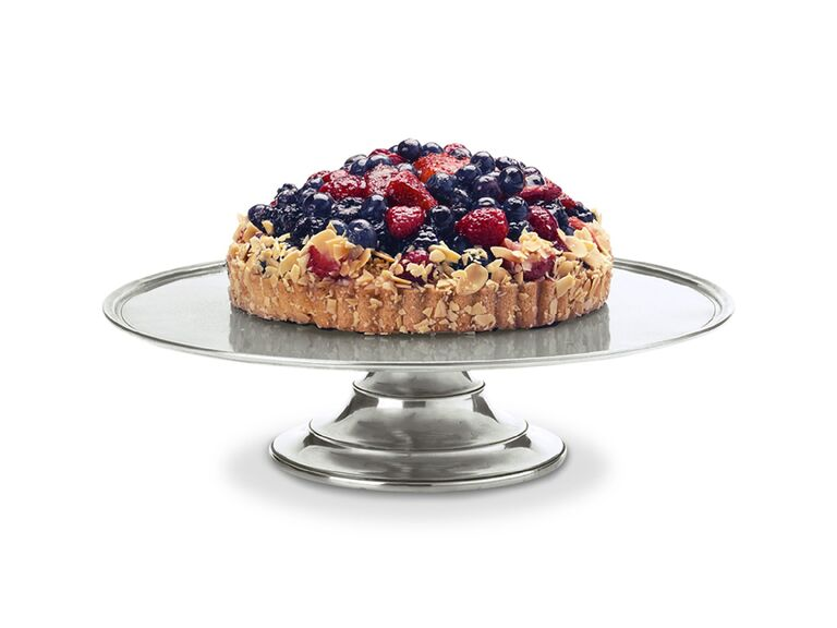 Short pewter wedding cake stand pictured with dessert flan