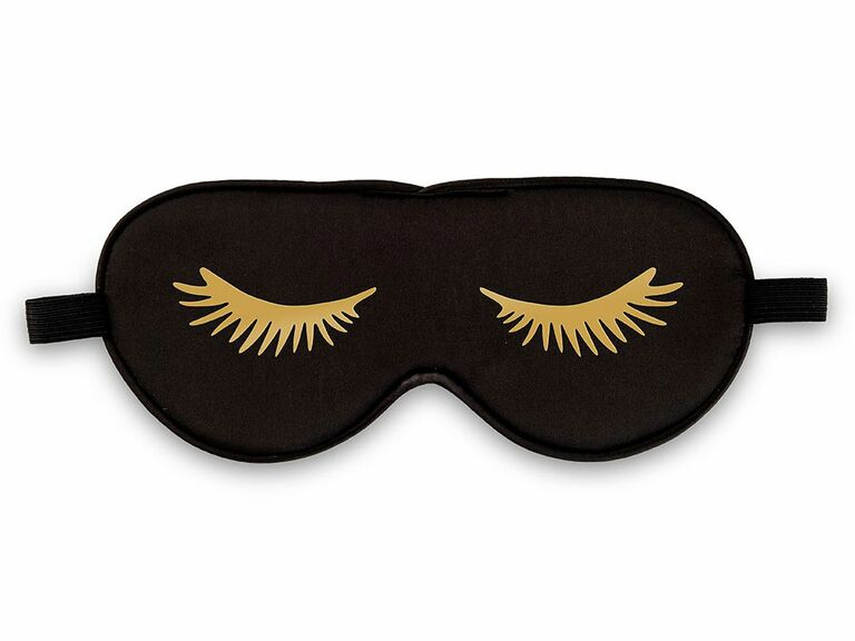 Black sleep mask with gold eyelashes as bachelorette party game prize