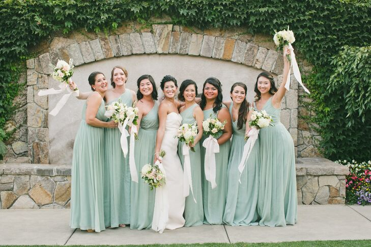 Jessica put a subtle twist on tradition when it came to the bridesmaid attire, selecting a floor-length sage-chiffon J.Crew dress for each woman and letting them choose a one-shoulder or V-neck style. For an elegant finish, they accessorized with shimmery stud earrings and elegant curled updos.