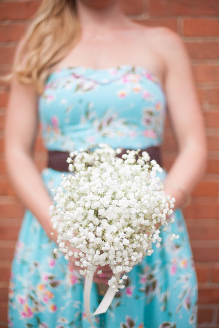 While Whitney used book pages to handcraft her own bridal bouquet, she and Jennifer opted for fresh blooms when it came to the bridesmaids. Each girl carried a simple bunch of baby's breath tied with an ivory ribbon down the aisle. The bouquets hinted at the wedding's rustic and vintage theme.