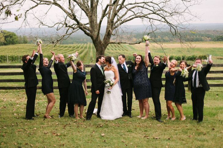 The bridesmaids, who chose their own dresses, wore different styles of navy dresses with lace details. The groomsmen wore black suits with blue ties.
