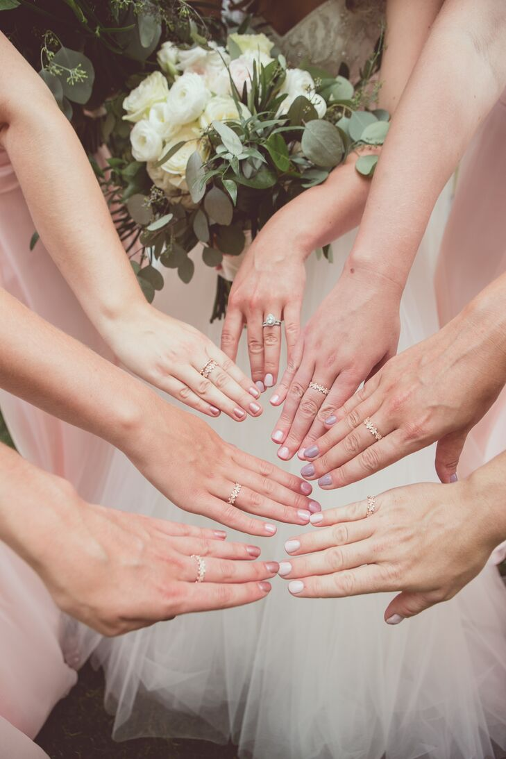 On the day of her wedding, Kelly-Ann gave bridesmaids matching rose gold rings, which they wore to celebrate their friendship.