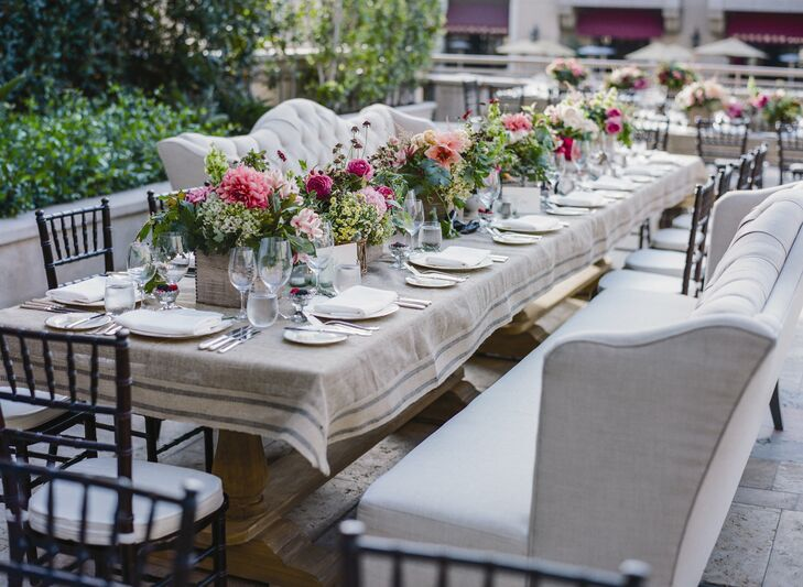 French-inspired linen cloths capped the tables, leaving the wooden-turned legs exposed for a rustic, country look.