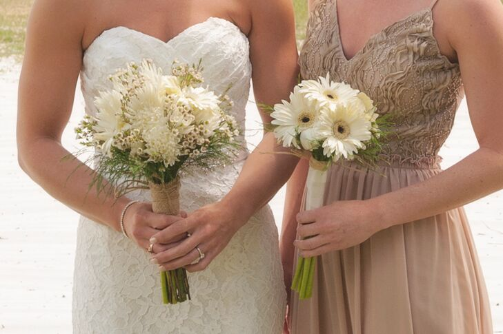 Holly and Jaime's bridesmaids paired their dresses with a simple and natural touch. Holly carried a bouquet of ivory chrysanthemums, baby's breath and greenery as her bridesmaids held arrangements of white gerbera daisies. Each arrangement was wrapped in twine to match the rustic decor.