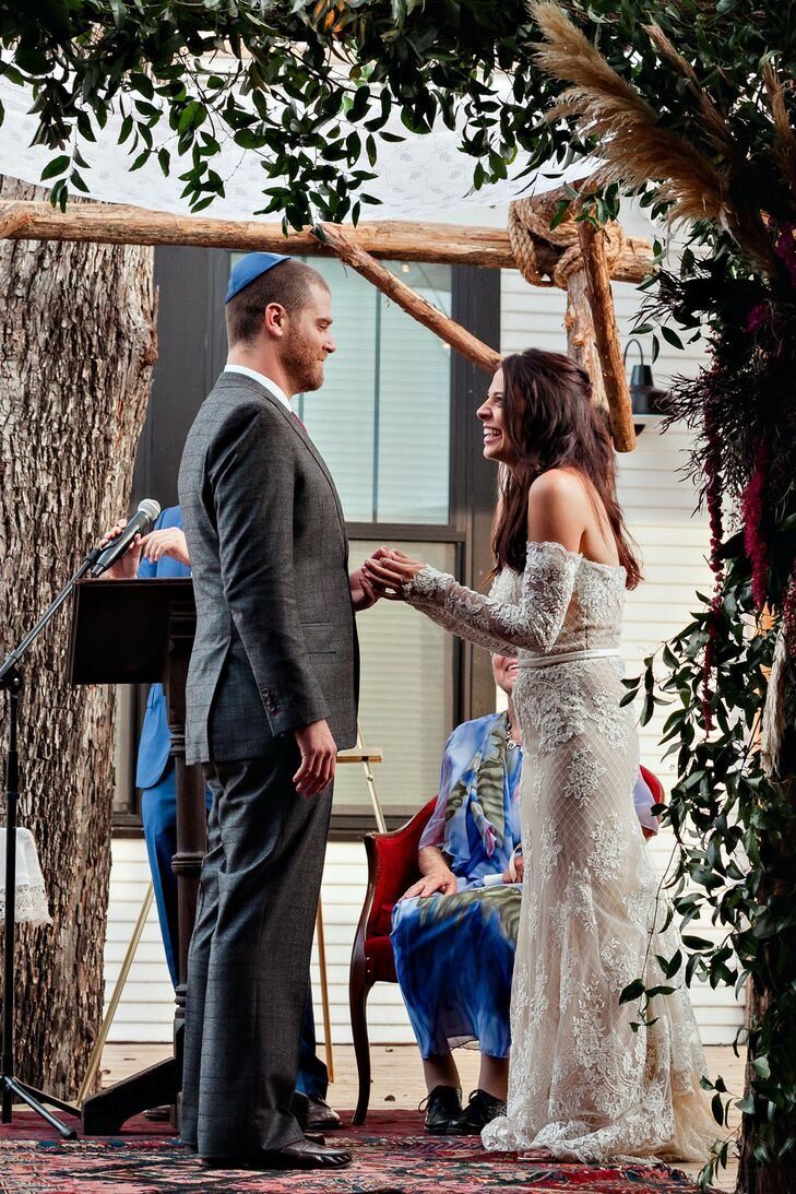 Couple Under Rustic Branch Chuppah