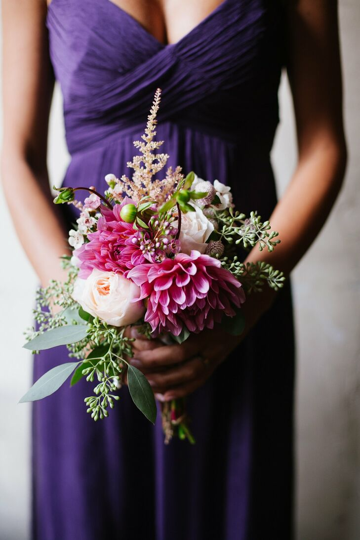 Hot pink dahlias were complemented by pale pink roses for the bridesmaid bouquets.