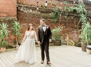 Jillian Bray and Gene Levin wed at the Art Factory in Paterson, New Jersey, since they immediately fell in love with the offbeat, industrial-chic spac