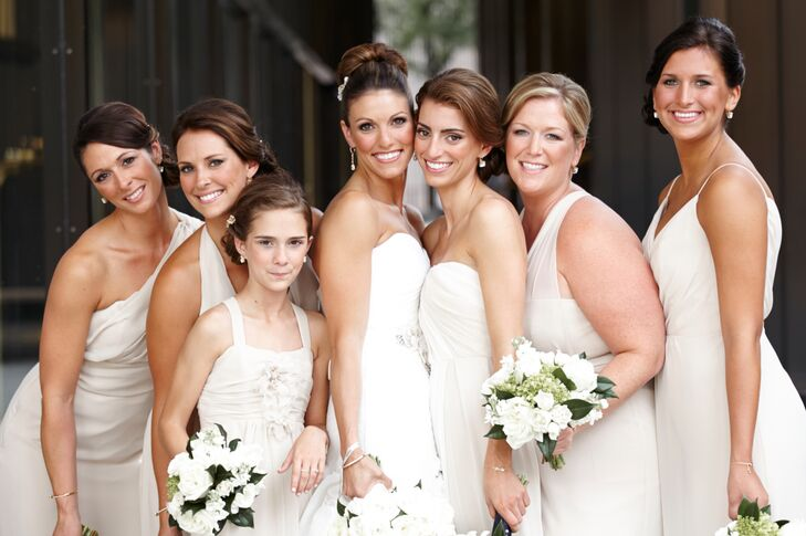 "Lindsey let each of her five bridesmaids pick their own style of dress – as long as it was by designer Jim Hjelm. ""I've been in enough weddings to know that not every dress looks good on every body type, so I chose the champagne color and designer and let them choose the actual style,"" she says. Lindsey's maid of honor even wore an ombre Jim Hjelm design to tie in the colors of the bride's ivory wedding dress with the remaining champagne gowns."