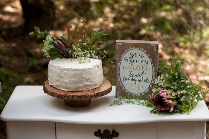 In keeping with the relaxed rustic setting in Grizzly Flats, California, Victoria and David cut into a simple roughly frosted, fern-topped wedding cake from Auntie Bea's Bakery. Guests enjoyed macarons and cupcakes from the same bakery.
