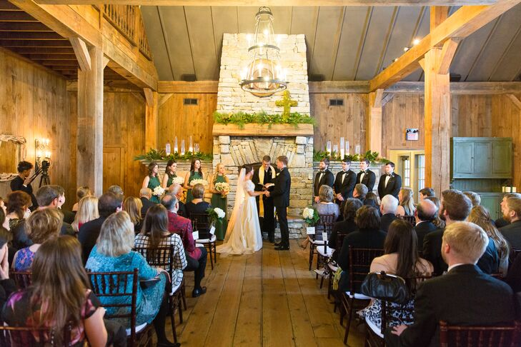 """Emily and Edward kept their ceremony decorations to a minimum since Old Edwards Inn and Spa in Highlands, North Carolina, was beautiful on its own. """"The Barn pavilion itself does not need much decor,"""" Emily says. """"It already is so lovely with the stone floors, huge fireplaces, wood beams and glass windows."""""""