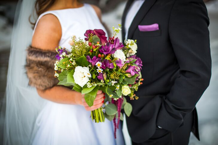Kelli's bouquet from Crab Apple Floral called upon the day's main color themes—lavender and ivory.