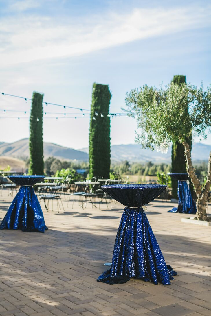 """""""There had to be a bit of shine in everything we did,"""" Ozzie says. Gilded details included sequined table runners and bold, fabric-wrapped tables during the couple's cocktail hour."""