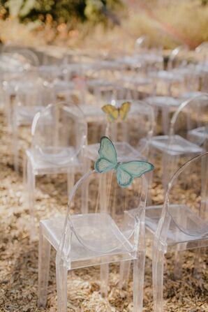 Ceremony Seating with Acrylic Ghost Chairs and Butterfly Accents
