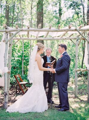 Outdoor Ceremony under a Wooden Arch