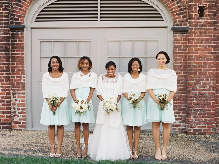 The bridesmaids wore knee length dresses in different styles from Target. They wore gold heels with their mint dresses. Alexandria and the bridesmaids wore fur stoles for this chilly, fall wedding.