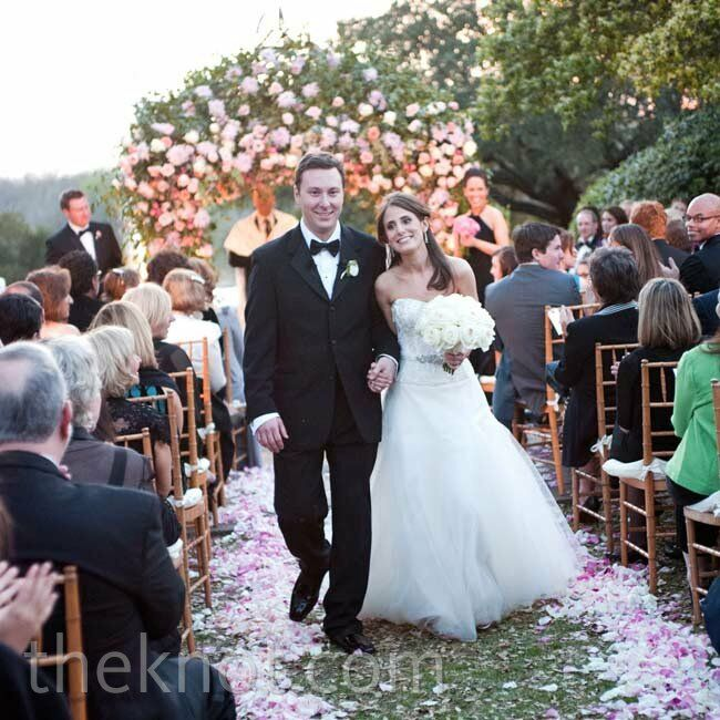 Allison and Zach complemented their outdoor setting with an abundance of pink flowers, petals and leaves.