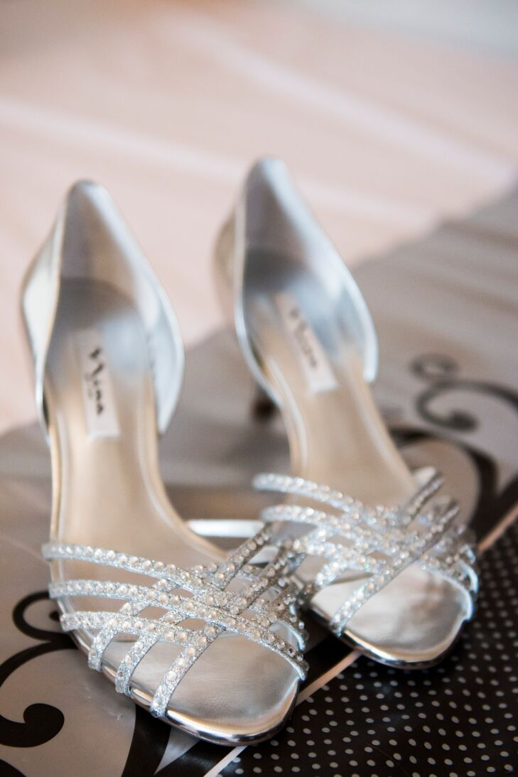 Jessica wore sparkly silver, crystal-embellished Nina shoes. The shoes were the perfect complement to the other metallics at the wedding, such as the stylish bridesmaid dresses.