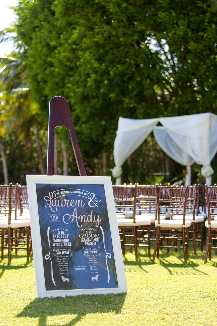 Instead of handing out programs, Lauren and Andy had all the ceremony information in one spot. A chic black, white and blush sign was placed at the head of the ceremony space. It had the names of those involved in this chic script with ribbon-inspired details along the sides.