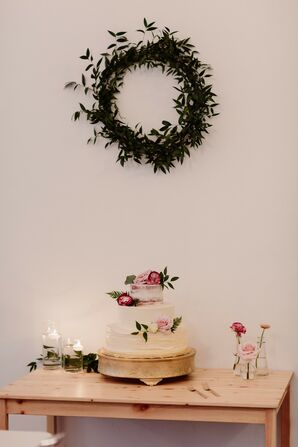 Simple Wedding Cake Display with Ruscus Wreath