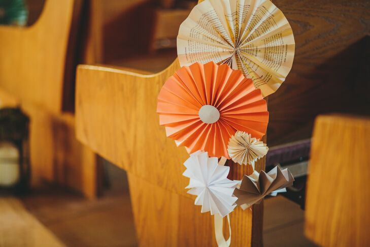 Brittaney made colorful paper pinwheel decorations coordinating with the day's palette, which decorated the pews at the church ceremony. Pinwheels made from book pages were incorporated into the mix as well, going along with the literary theme of the wedding.